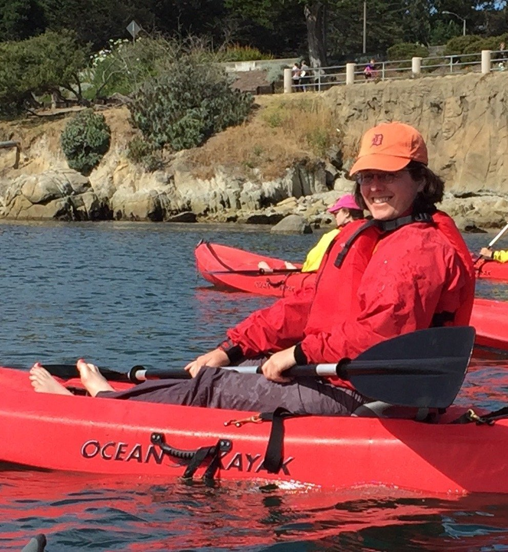 Ricki kayaking with the sea otter in Monterey Bay